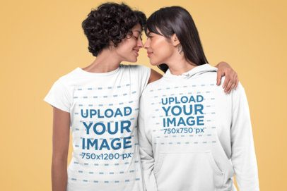 Mockup of a Romantic Couple Wearing a T-Shirt and a Hoodie at a Studio 30391