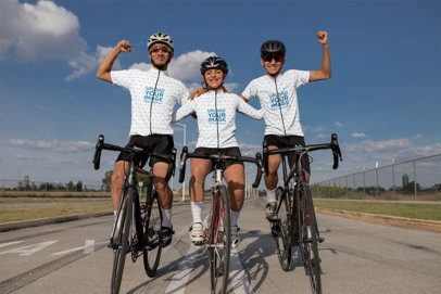 Mockup of Three Friends Wearing Cycling Jerseys and Celebrating 30789