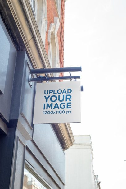 Mockup of a Store Sign Placed on a Classical-Style Building 1334-el