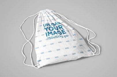 Drawstring Bag Mockup Lying on a Flat Surface 823-el