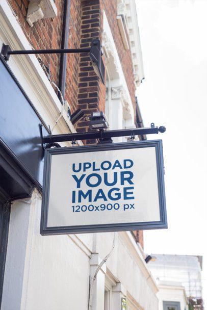 Mockup of a Shop Sign at a Clear Street 1337-el