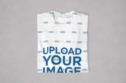 Mockup of a Sublimated Tee Neatly Folded Against a Flat Surface 1046-el