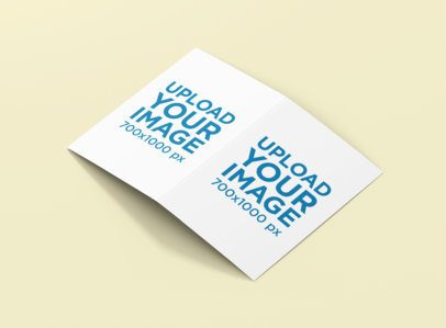Mockup of an Open A5 Brochure Placed on a Plain Color Surface 1374-el