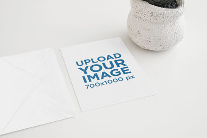 Mockup of a Postcard and an Envelope Beside a Small Plant Pot