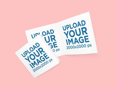 Mockup of Two Open Greeting Cards Placed Against a Flat Surface 1139-el