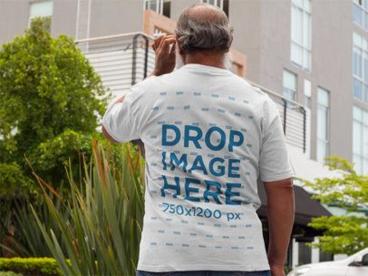 Back of a Middle Aged Man Wearing a T-Shirt Mockup on the Street a11095b