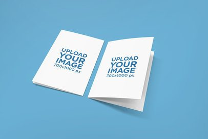 Back and Front View Mockup of Two Greeting Cards Placed over a Solid Color Backdrop 1611-el