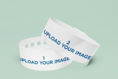 Mockup of Two Vinyl Wristbands Placed in a Minimalist Setting 1394-el