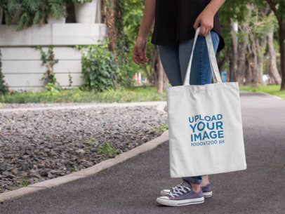 Tote Bag Mockup Featuring a Woman Near a Park a11460