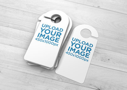Mockup of Several Door Hangers Stacked on a Wooden Surface 1738-el