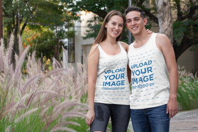 Mockup of a Happy Couple Wearing Tank Tops by Some Plants 30749