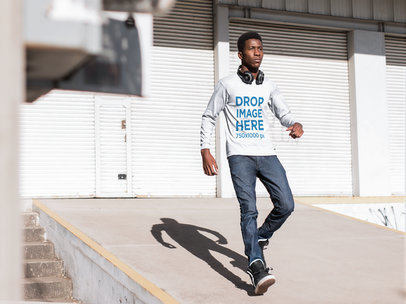 Long Sleeve T-Shirt Mockup Featuring a Young Black Man Near a Storage Area b8816