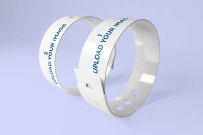 Mockup of Two Vinyl Wristbands Placed inside a Minimalistic Scenery