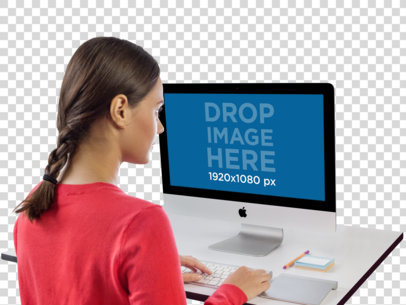 iMac Mockup of a Woman Working at Her Desk a11426