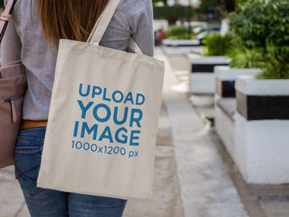 Canvas Tote Bag Mockup Over a Woman's Shoulder a11492