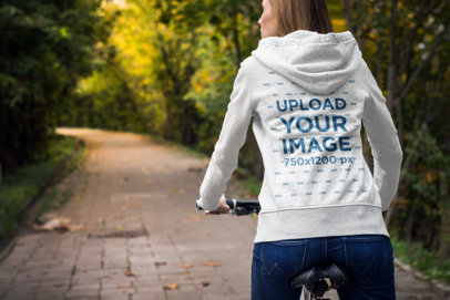 Heather Hoodie Mockup Featuring a Young Woman Riding Her Bike at a Park 1782-el