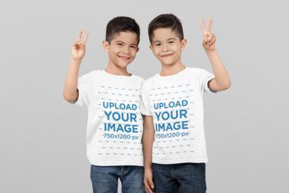 T-Shirt Mockup of Twin Boys Saying Hi at a Studio
