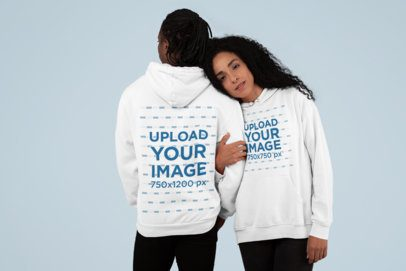 Both-Sides View Mockup of a Couple Wearing Pullover Hoodies at a Studio 30771