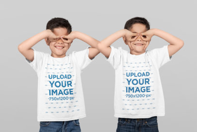 T-Shirt Mockup of Identical Twin Boys Making Funny Faces at a Studio