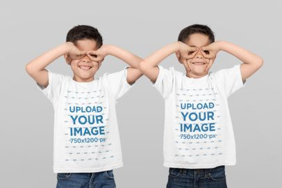 T-Shirt Mockup of Identical Twin Boys Making Funny Faces at a Studio 31000