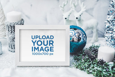 Mockup of an Art Print Surrounded by Christmas Ornaments 2090-el