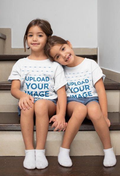 T-Shirt Mockup of Twin Girls Sitting on the Stairs 31020