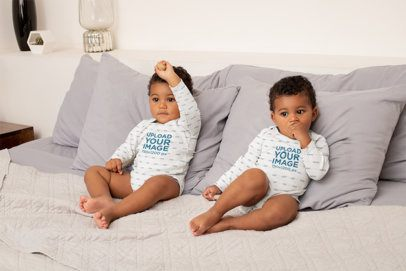 Sublimated Onesie Mockup Featuring Twin Baby Brothers on a Bed 31023