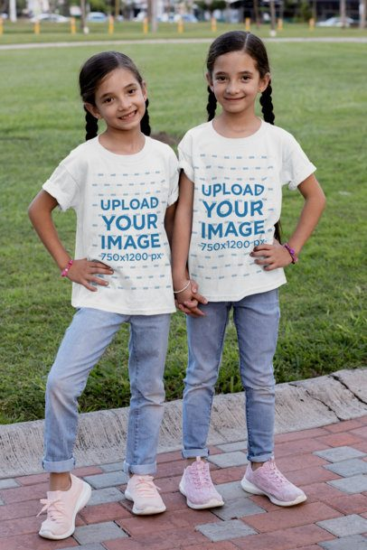 T-Shirt Mockup of Two Identical Twin Girls at the Park 30705