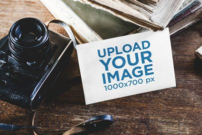 Mockup of a Postcard Beside a Vintage Camera 2133-el