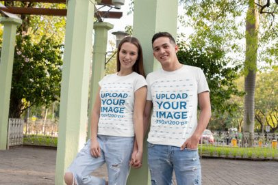 T-Shirt Mockup of a Couple Holding Hands at the Park 30744