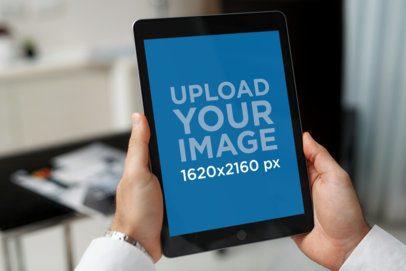 Mockup of a Man's Hands Holding an iPad Mini 2108-el1