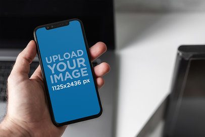 Mockup Featuring a Man's Hand Holding an iPhone 11 Pro 2131-el1