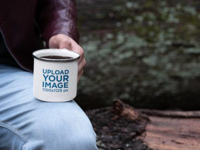 Mockup of a Man Holding a 12 oz Enamel Mug with Silver Rim 30817