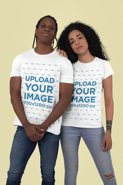T-Shirt Mockup of a Man and a Woman Posing Against a Plain Color Backdrop 30760