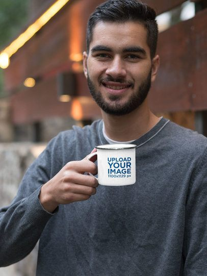 Mockup of a Smiling Man Holding His 12 oz Silver Rim Enamel Mug 30812