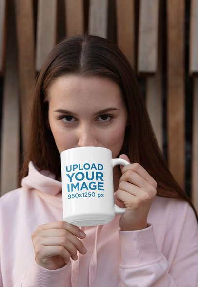 Mockup of a Woman Drinking Coffee from a 15 oz Mug 30825