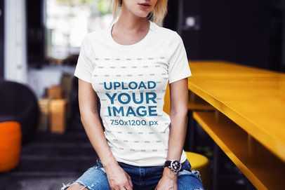 Cropped Face T-Shirt Mockup Featuring a Woman Sitting on a Stool 2228-el1