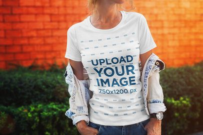 Mockup of a Woman Showing of Her T-Shirt From Under a Denim Jacket 2230-el1