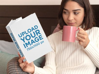 Hardcover Book Mockup Featuring a Woman Reading in Bed 31036