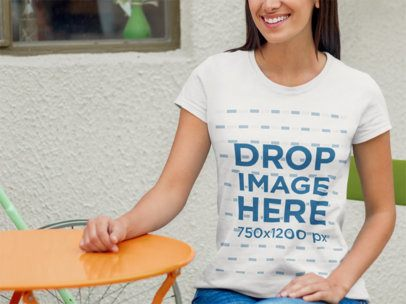 T-Shirt Mockup of a Smiling Young Woman at a Restaurant 8314
