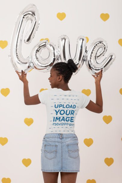Back-View T-Shirt Mockup of a Woman Holding Valentine's Day Balloons 31213