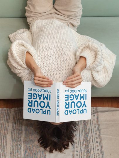 Mockup of a Woman Reading a Squared Book Upside Down 31046