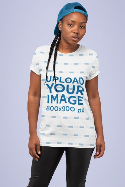 Sublimated T-Shirt Mockup Featuring a Serious-Looking Woman at a Studio 31140