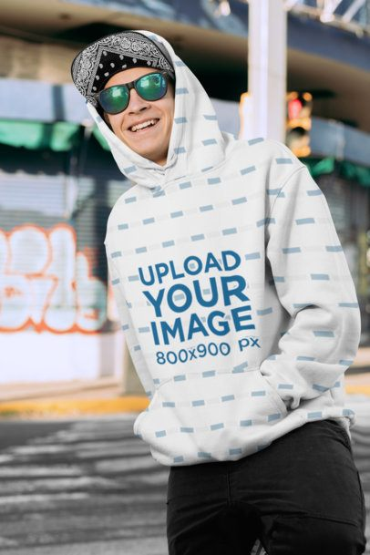 Mockup of a Smiling Man Wearing a Sublimated Pullover Hoodie 31130