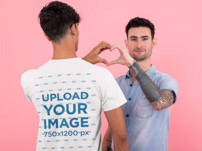 Back View Mockup of a Man with a T-Shirt Doing a Heart Sign with His Boyfriend 31206