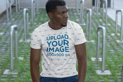 Sublimated T-Shirt Mockup Featuring a Man with Bike Racks in the Background 31374