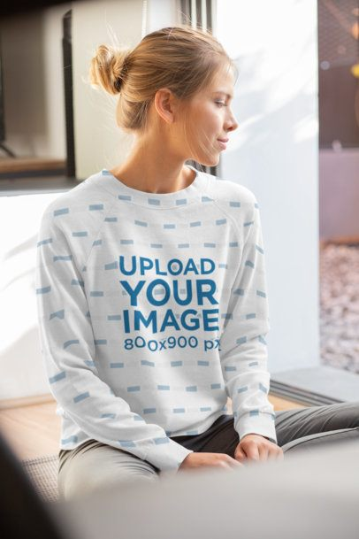 Mockup of a Young Woman Wearing a Sublimated Sweatshirt 31250