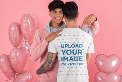 Back View T-Shirt Mockup Featuring an LGBT Couple Surrounded by Heart-Shaped Balloons 31210