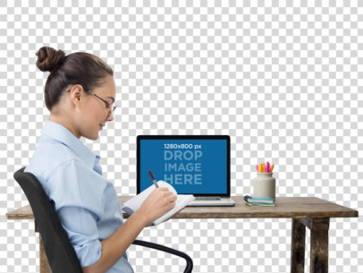PNG Macbook Mockup of an Office Woman Writing in Her Notebook a11688
