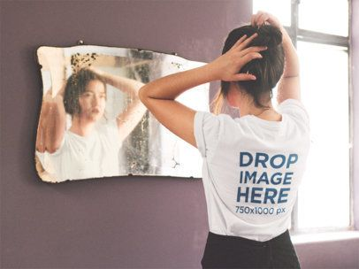 Backside T-Shirt Mockup of a Girl Staring in a Mirror a11665